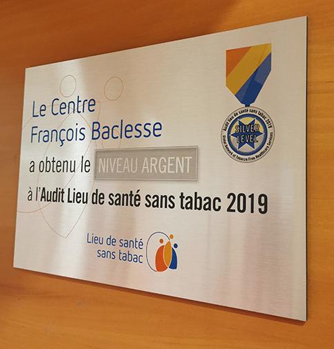 """Plaque """"Le Centre Baclesse obtient le Niveau Argent à l'Audit Lieu de santé sans tabac 2019"""""""